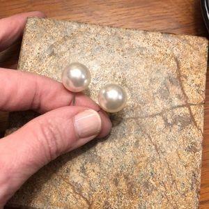 Large pearl earrings.